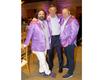 2021 AWARE Affair_David McDavid, Honorary Chair Emeritus, Tim O'Connor, Randy Barnes all in their AWARE Men's purple jackets.png