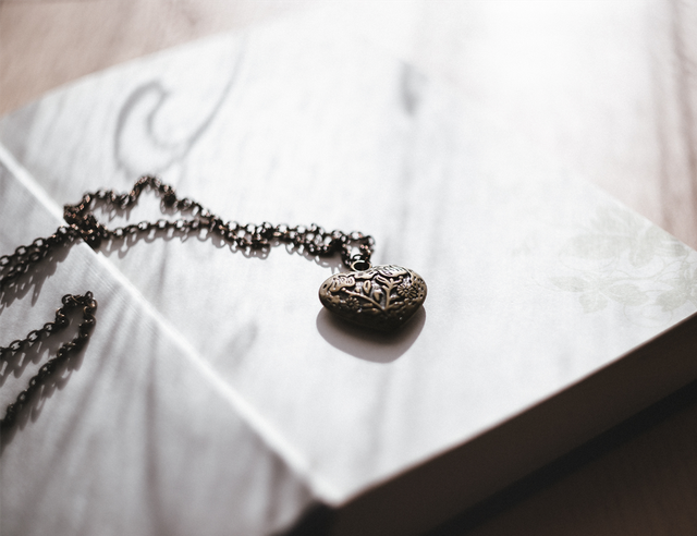 Locket Necklace on Open Book Commemorate a Loved One_ Public Domain CC0 Image via rawpixel.png